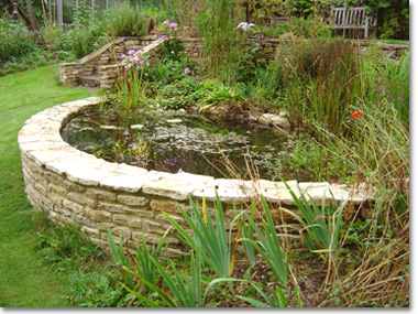 Raised pond with stone walls