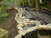 The rubber liner and large natural paddle stones