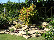 It is now a terraced rockery made from Cotswold Stone